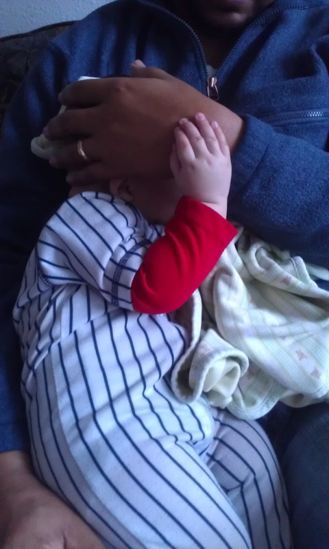 fell asleep on daddy, holding his hand like this ...