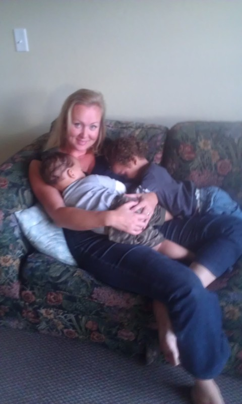 maddie caught both boys on mama's lap ... they laughing!