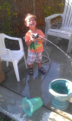yesterday, when he figured out he could spray me! cracking up!