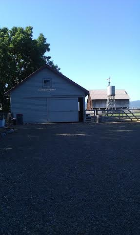 the barn door is closed here but the door on the right is the one that opens to her farm stand